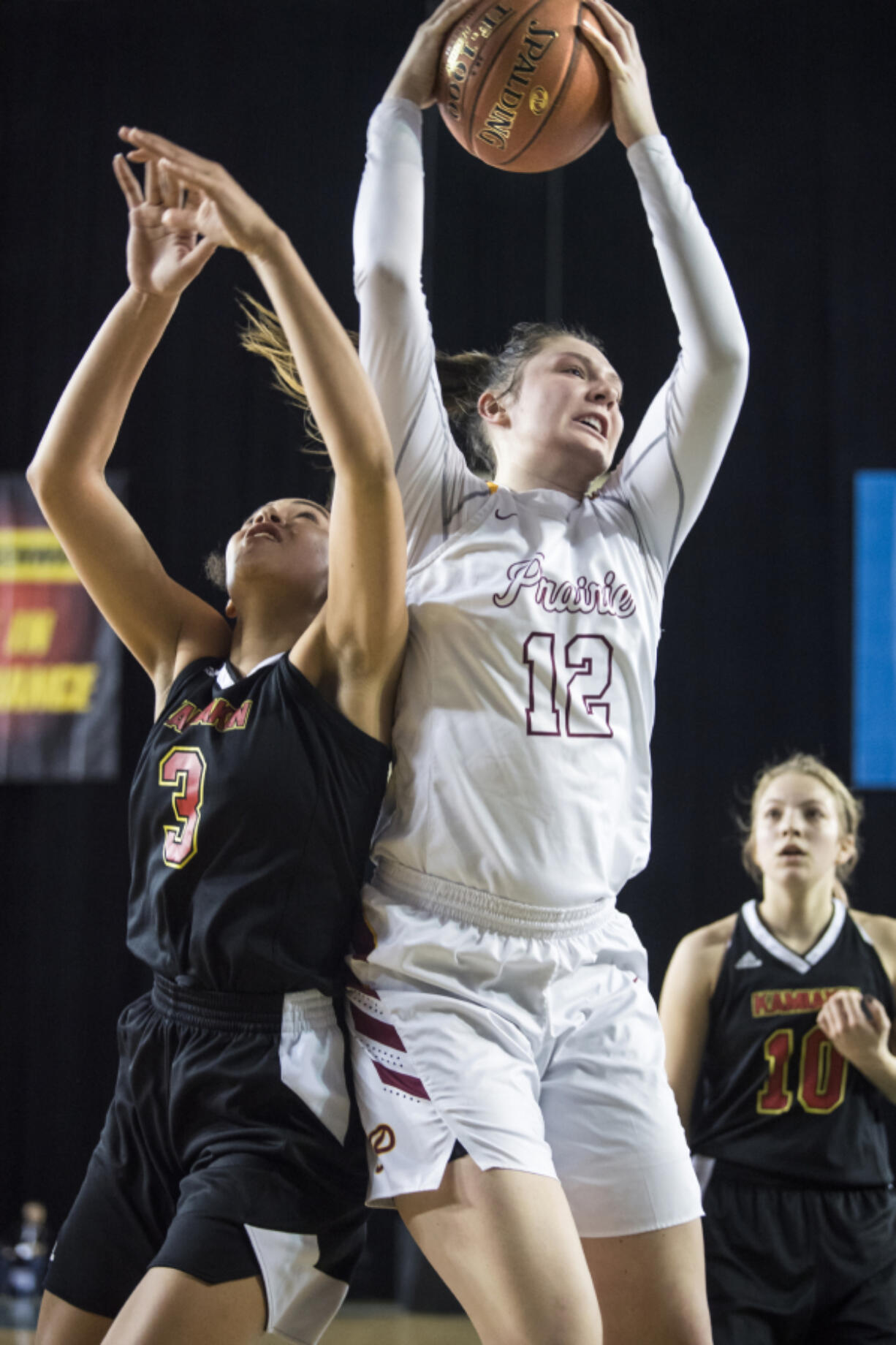 Prairie's Brooke Walling beats Kamiakin's Symone Brown to a rebound during the 3A Hardwood Classic at the Tacoma Dome on Friday March 1, 2019.