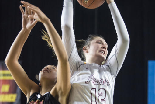 Prairie's Brooke Walling beats Kamiakin's Symone Brown to a rebound during the 3A Hardwood Classic at the Tacoma Dome on Friday March 1, 2019.  (Nathan Howard/The Columbian)