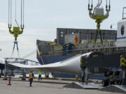 Workers unload wind blades bound for Canada from the MV Star Kilimanjaro at the Port of Vancouver on May 4, 2020. The ship departed China on April 13 and held 27 blades for nine wind turbines.