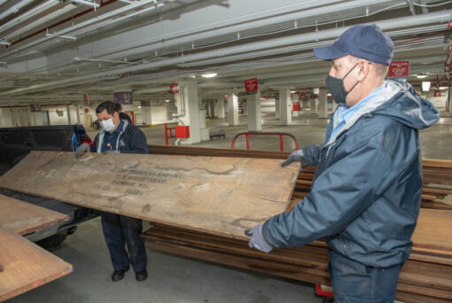 Architects of the Capitol staff hold rare century-old mahogany obtained from a U.S. Forest Service lab storage locker in Wisconsin. This historic mahogany lumber, received from USDA Forest Service's Forest Products Laboratory, will be used to replace U.S. Capitol doors and other wood details damaged during the January 2021 breach.