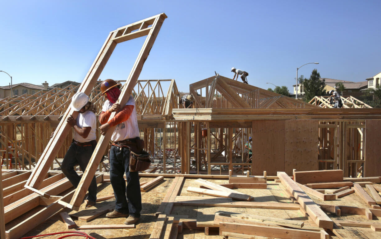Workers put the framing up on new single family luxury homes in Porter Ranch, Los Angeles, California on October 9, 2014. Construction is among the industries that have made significant use of the H-2B guest worker program.