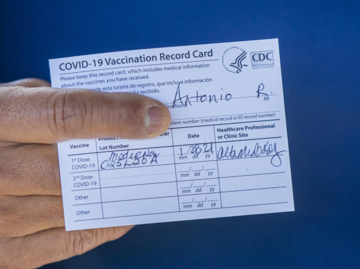 Former Los Angeles Mayor Antonio Villaraigosa holds his vaccination card after receiving his first shot of the Moderna COVID-19 vaccination in January 2021. (Allen J.