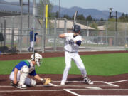 Skyview'is Kyle Olson stands at the plate while Mountain View catcher Riley McCarthy awaits the pitching during Monday'is game at Union High School.