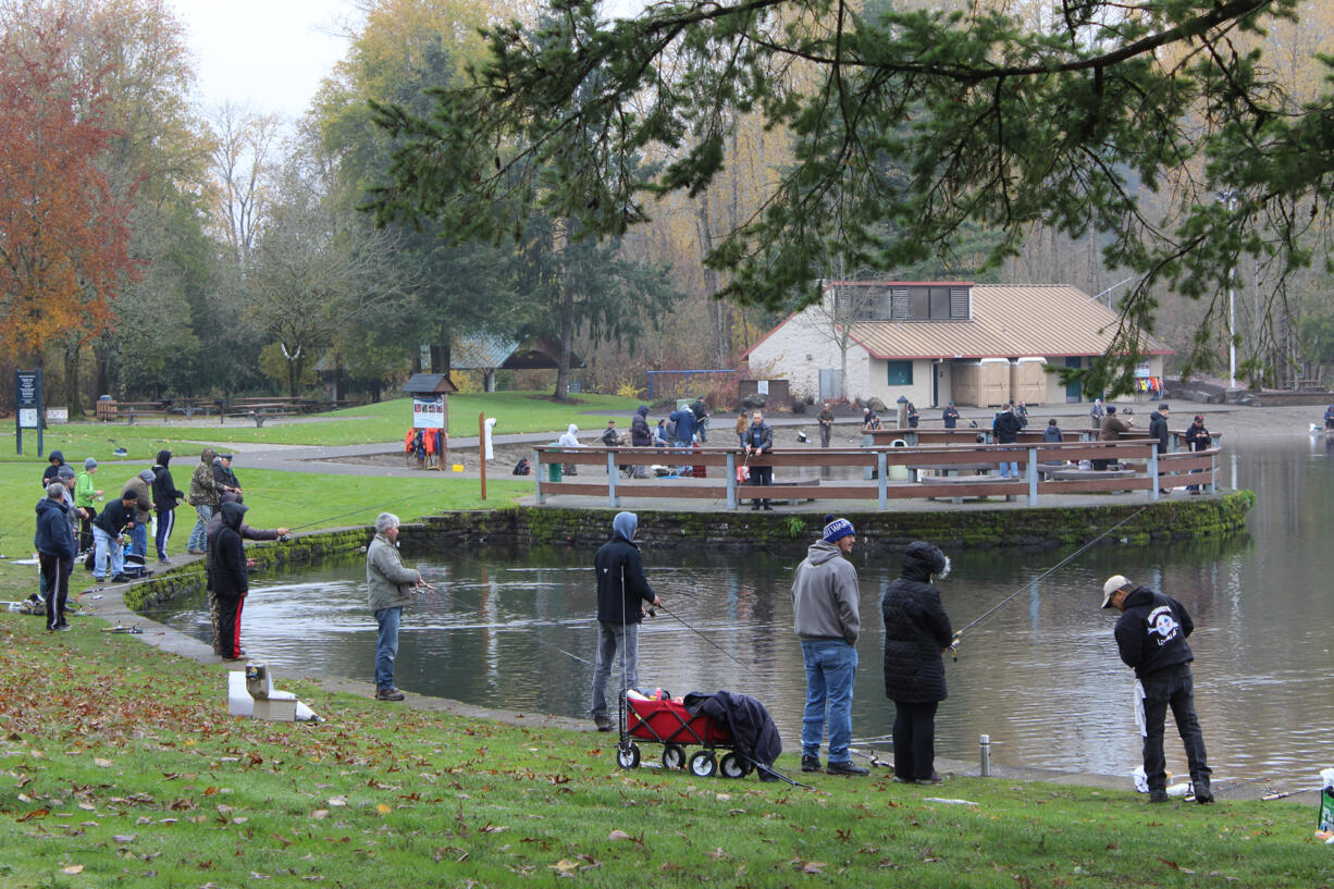 Anglers try their luck for rainbow trout at Klineline Pond north of Vancouver. The 2021 statewide trout fishing season kicks off on Saturday, and Klineline Pond is one of many waters stocked with trout.