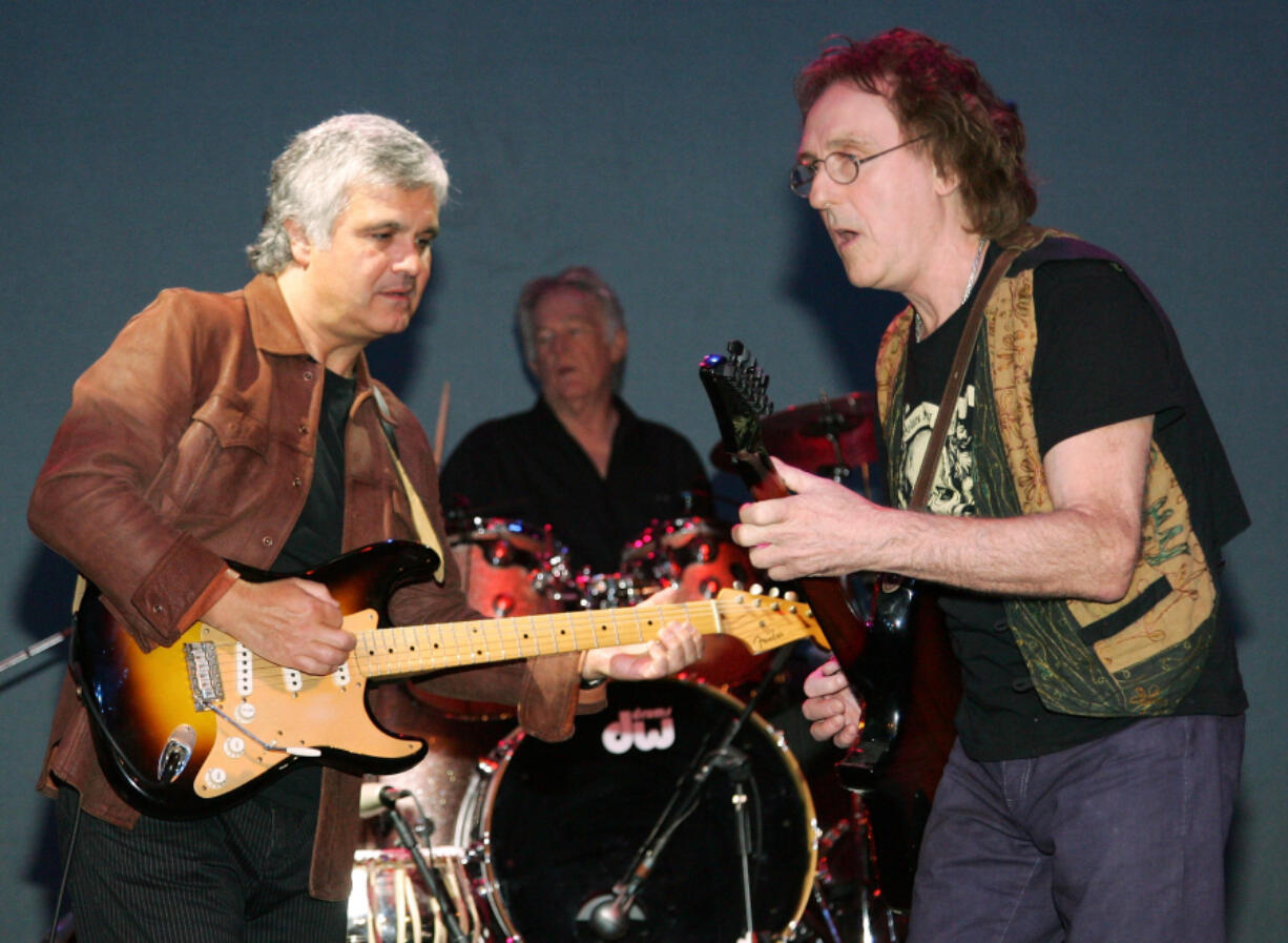 Former members of the band Wings, from left, Laurence Juber, Denny Seiwell and Denny Laine, perform at the Fest for Beatles Fans 2007 at The Mirage Hotel & Casino in Las Vegas.