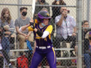 Columbia River's Sophie Reyes awaits the pitch during the third inning Friday against Woodland. She would hit a three-run home run later in the at-bat.