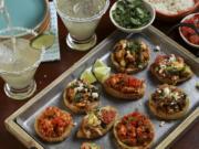 Chalupas and sopas made of chorizo with potato, tofu, and chicken with avocado.