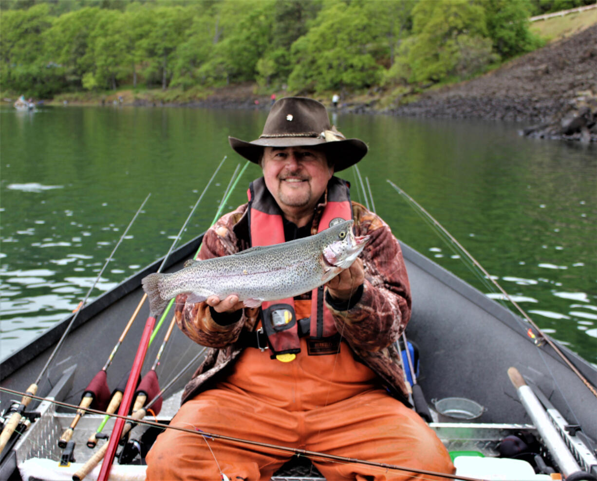 Buzz Ramsey with a brooder rainbow trout he caught while fishing Rowland Lake last Saturday during the spring trout opener. A number of other anglers were also lucky enough to find one of the big boys.