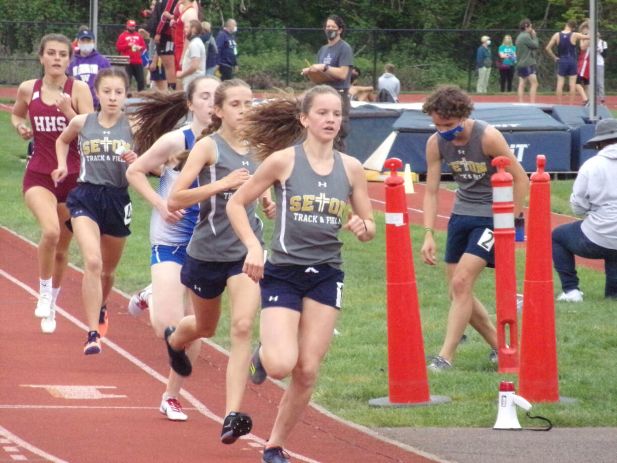 La Center's Lara Carrion lead the pack in the girls 1,600 meters at the 1A district track and field meet on Friday, April 30, 2021. Carrion went on to win the race in 5:13.97.