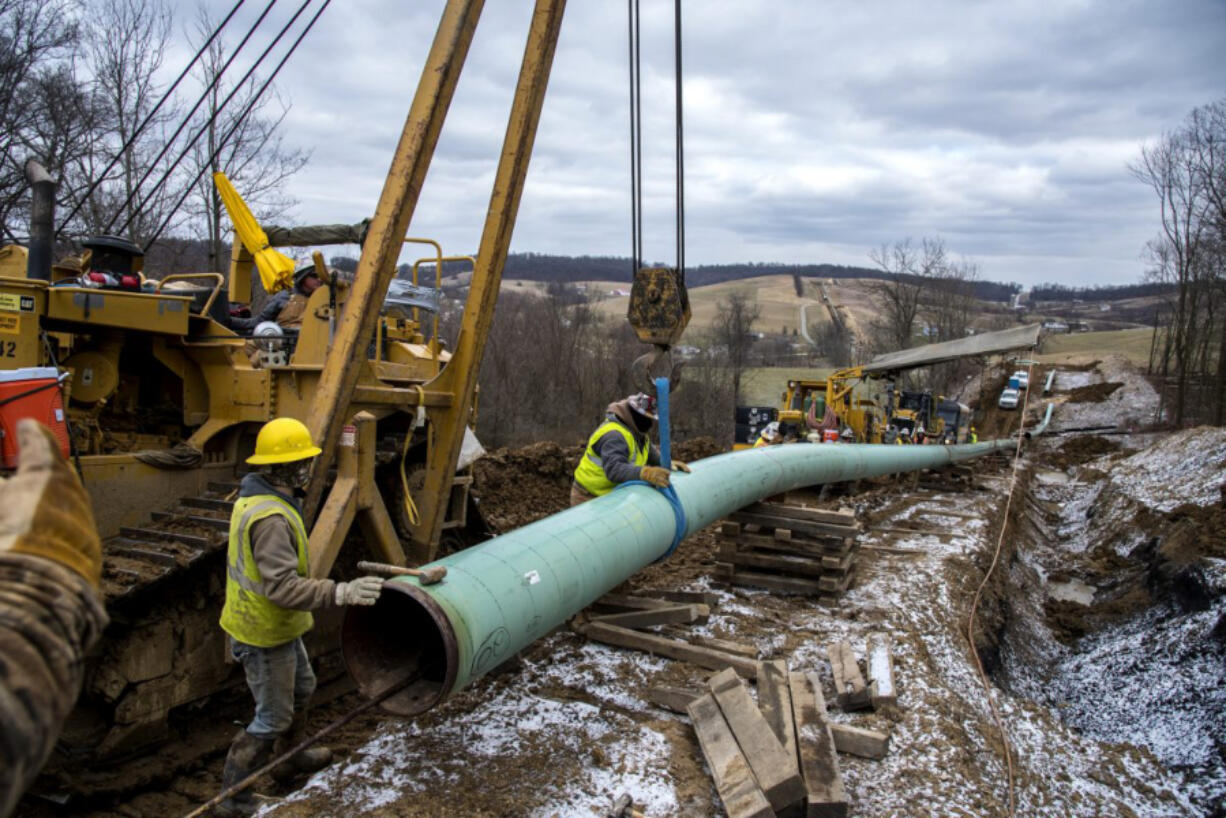 Workers install the Mariner East 2 pipeline in Pennsylvania in 2018. The PennEast Pipeline, which would connect Pennsylvania and New Jersey, is subject of a legal dispute that was argued Wednesday before the U.S. Supreme Court.