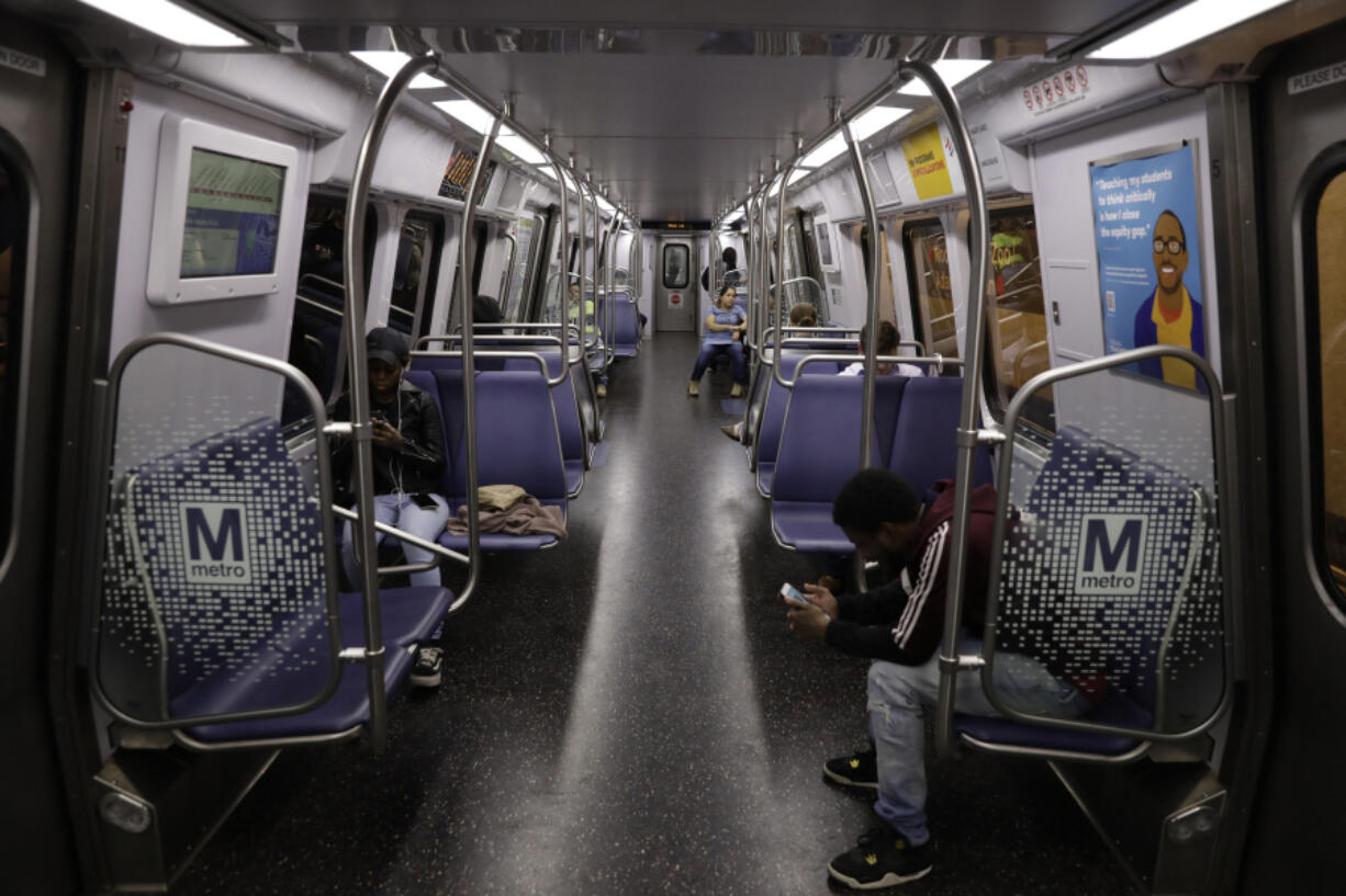 Passengers on a Metro train in Washington, D.C., on Friday, March 20, 2020.