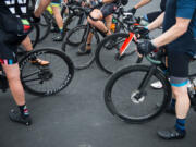 Cyclists take a break from the 2019 Ride Around Clark County event at a Ridgefield fire station. The ride will be back this year in modified form, organizers with the Vancouver Bicycle Club say.