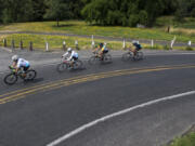 A Vancouver Bicycle Club group ride rolls along Lower River Road in summer 2019. The coronavirus pandemic put a brake on the club's activities last year, but now organizers say things are moving again.