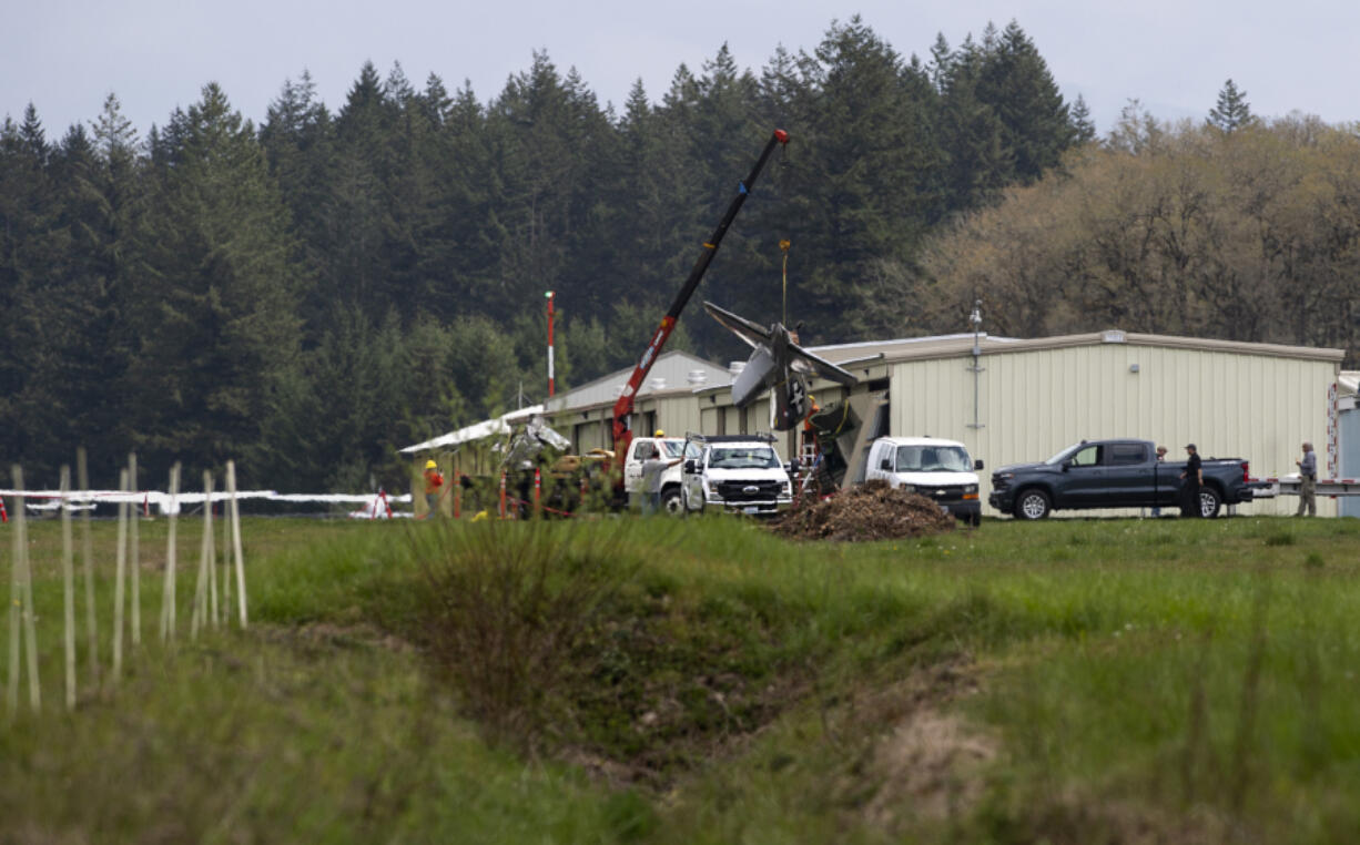 Crews work Thursday to remove a small plane that crashed into the far west hangar at Grove Field. A family member said Mark Lewallen of Vancouver died in the crash, while a second pilot providing instruction was seriously injured in the crash, which occurred around 3:15 p.m. Wednesday. The National Transportation Safety Board and Federal Aviation Administration were investigating the incident Thursday.