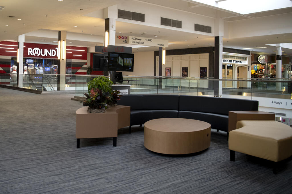 A new seating area sits empty in front of Round 1, which opens this weekend, and Cue Topia, which opened recently at Vancouver Mall.