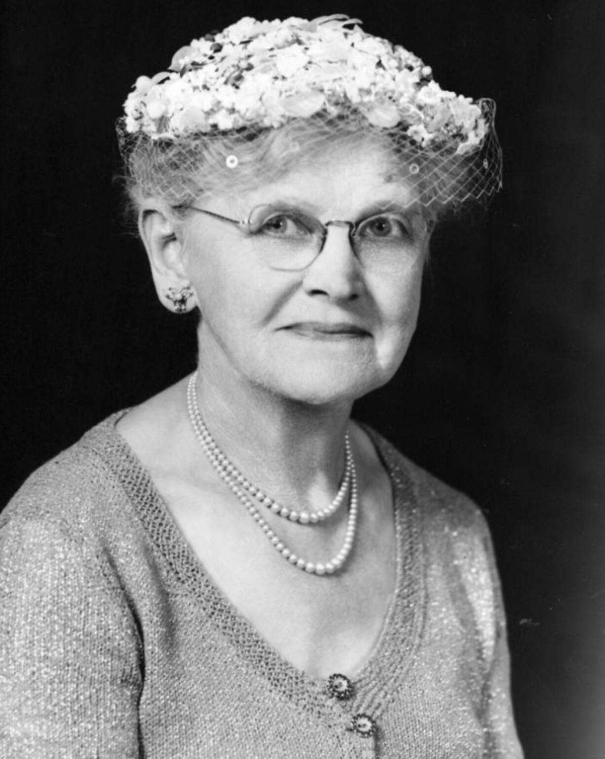 Mrs. Hilma Powers contributed $10 to the Vancouver Soroptimist club to have a photo taken wearing Mamie Eisenhower's hat. The first lady donated the hat shown to support the organization's 1955 fundraiser. Powers' money went toward restoring the Vancouver Barracks Officers' Quarters.