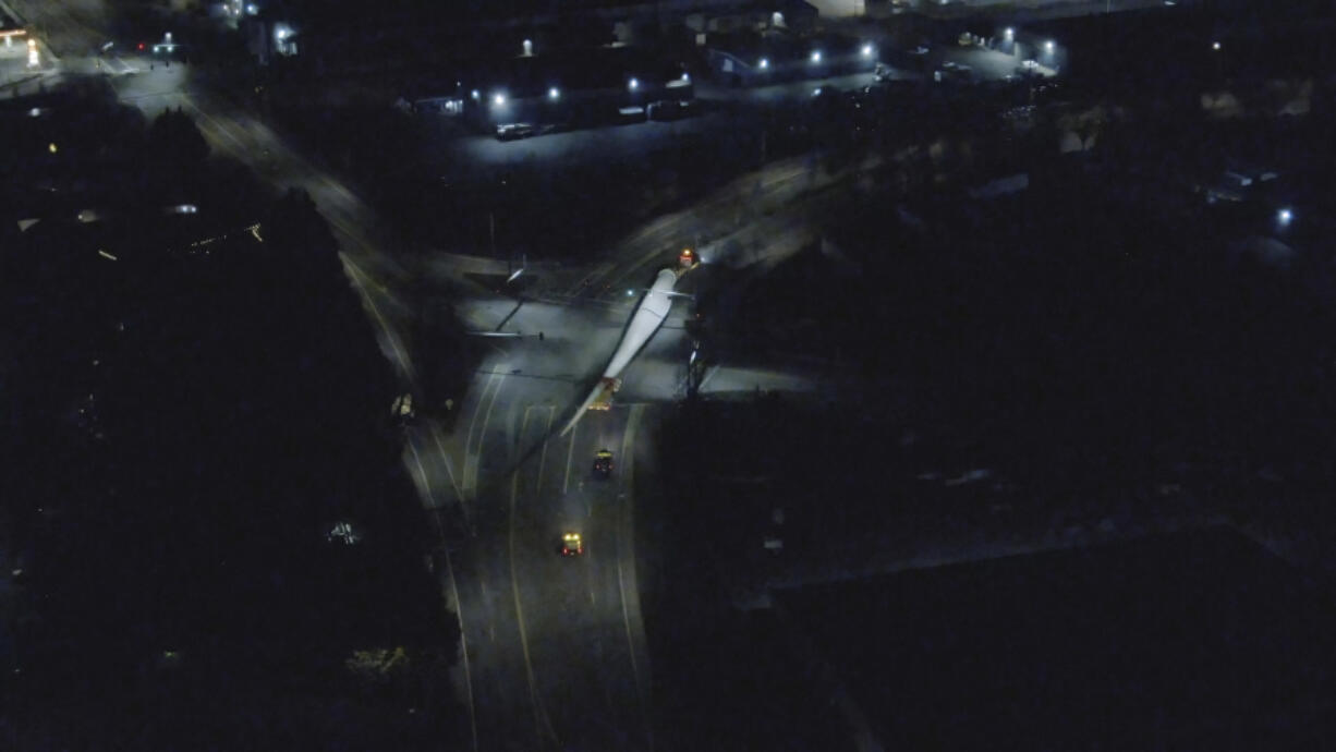 Aerial photos taken by a drone follow the progress of a wind turbine blade as it leaves the Port of Vancouver in the early morning hours of April 1. Wind energy components imported at the port are typically trucked farther inland using Interstate 84 through the Columbia River Gorge.