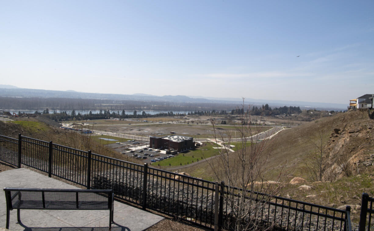 The Columbia Palisades development, as seen from the bluff that lines the northern and eastern sides of the site. The eastern half of the former Fisher Quarry is poised to become a major development hub along the 192nd Avenue corridor.  At top, Romano Capital recently wrapped up work on the Westridge apartment complex, one of four projects that the company has been working on within the 192nd Avenue corridor. Company President Kess Romano said he sees the eastern corridor and Ridgefield as Clark County's two biggest development hot spots at the moment.