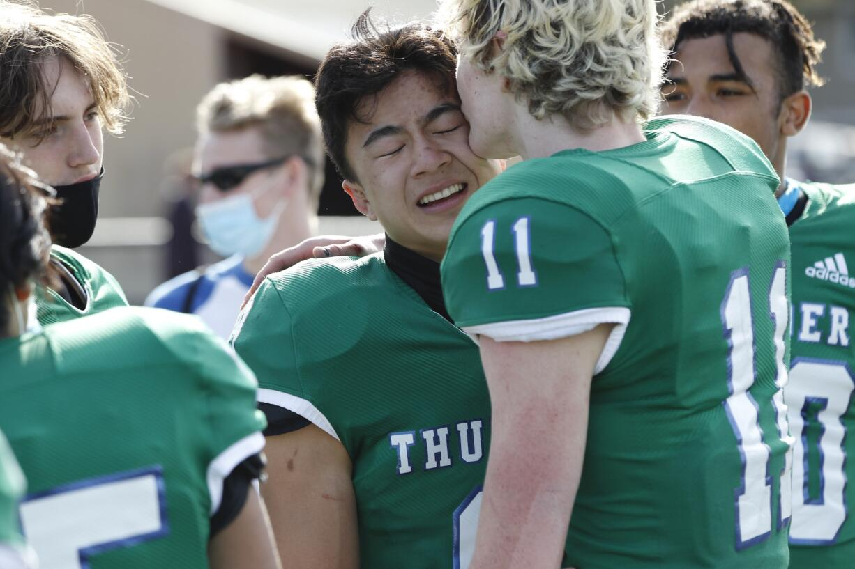 Mountain View running back Kevin Chen, left, is congratulated by teammate Zach Gable, right, after a win against Heritage Friday afternoon at McKenzie Stadium.