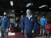 Francisco Bueno, executive director of the Boys & Girls Clubs of Southwest Washington, joins Gov. Jay Inslee during a tour of the Teen Turf club Friday afternoon. Inslee's visit also included stops at Eleanor Roosevelt Elementary School and the Tower Mall vaccination site.