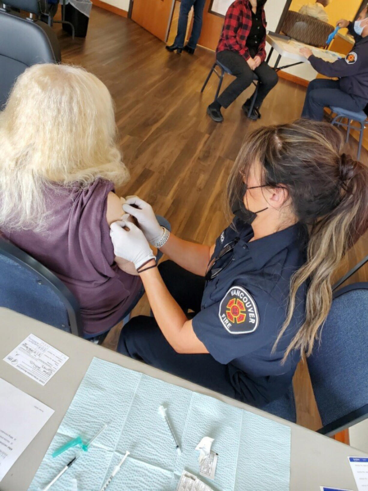 CLARK COUNTY: Members of the Vancouver Fire Department are helping at various sites with the COVID-19 vaccine rollout.