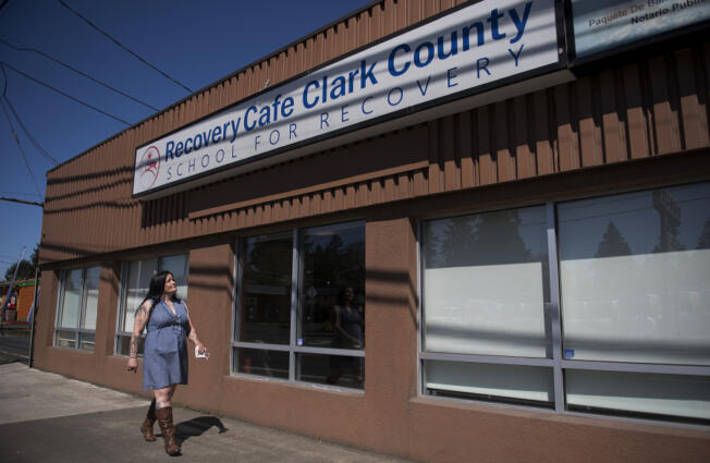 Nicholl Acosta-Alaspa of Vancouver walks at Recovery Cafe Clark County in Vancouver. Acosta-Alaspa has gone through the difficult process of recovery during the pandemic, which has been a lonelier, less stimulating time for most people.