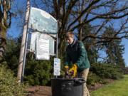 Zac French, 14, of Battle Ground puts leaves and other debris into a trash can Saturday at Kiwanis Park during Battle Ground's Park Appreciation Day.