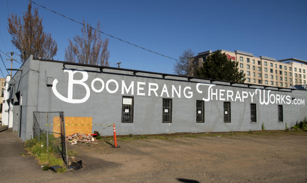 Boomerang Therapy Works is moving to a new location next month because its current building is set to be demolished to make way for an apartment building. The taped-off section of the exterior wall was where a car drove into the building recently.
