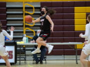 Union's Abbey Kaip leaps to save the ball from going out of bounds in a 4A/3A Greater St. Helens League girls basketball game on Thursday, April 22, 2021, at Prairie High School. Union won 50-46.