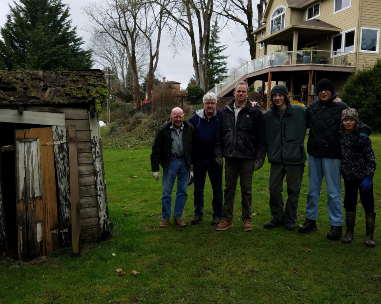 OLD EVERGREEN HIGHWAY: From left is Don Stuart (great grandfather), Paul Cline (grandfather), Jeremy Stuart (father), Tiger, and brothers Ryker and Rogen Stuart, both Star Rank Scouts with Troop 14, at the Jane Weber Evergreen Arboretum.