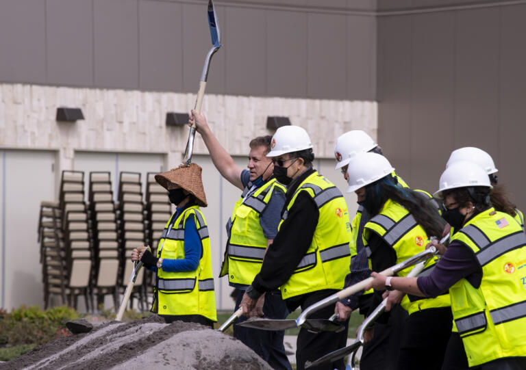 Cowlitz Tribe vice chairman Dick Barnett raises his shovel in the air after making some of the first digs on Friday, April 23, 2021, at the ilani on the Cowlitz Indian Reservation. The casino broke ground Friday on a 14-story luxury hotel.