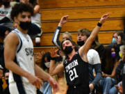 Union High School senior Cole Rebman, 21, celebrates a three point shot Tuesday, April 27, 2021, during the TitanÕs 79-71 win against Skyview High School at Skyview.
