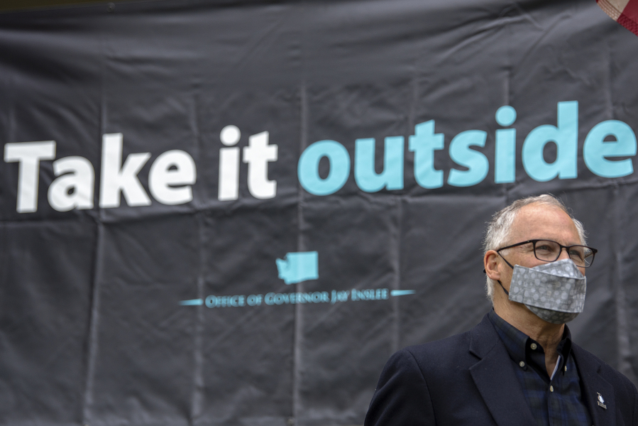 Gov. Jay Inslee's Vancouver stops on Friday included the Grant House, where he promoted outdoor gatherings to combat the spread of COVID-19.