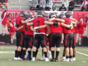 Camas football players huddle up prior to their game Friday against Prairie (Tim Martinez/The Columbian)