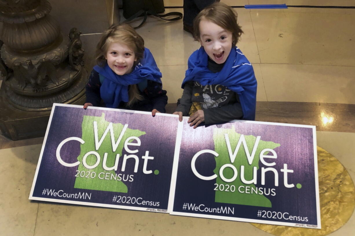 FILE - In this April 1, 2019 file photo, Noelle Fries, 6, left, and Galen Biel, 6, both of Minneapolis, attend a rally at the Minnesota Capitol to kick off a year-long drive to try to ensure that all Minnesota residents are counted in the 2020 census. Minnesotans spent 18 months worrying over whether the 2020 Census would finally cost them a precious seat in Congress. Residents voluntarily returned their census forms at the highest rate in the nation. Their dedication likely saved the day.