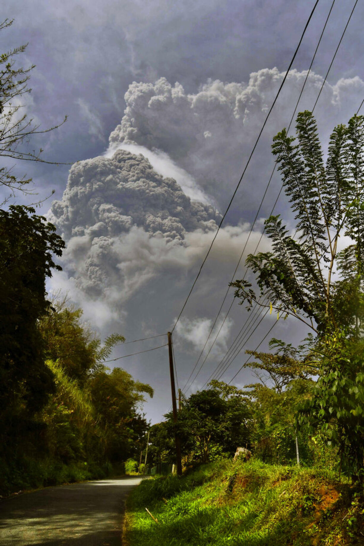 Plumes of ash rise from the La Soufriere volcano as it erupts on the eastern Caribbean island of St. Vincent, as seen from Chateaubelair, Friday, April 9, 2021.
