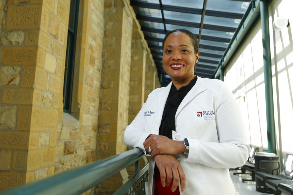 """Dr. Mysheika W. Roberts, the health commissioner for Columbus Public Health, poses for a portrait in Columbus, Ohio, on Wednesday, April 14, 2021. Public health officials who have juggled bare-bones budgets for years are happy to have the additional money prompted by the COVID-19 pandemic. Yet they worry it will soon dry up as the pandemic recedes, continuing a boom-bust funding cycle that has plagued the U.S. public health system for decades. If budgets are slashed again, they warn, that could leave the nation where it was before covid: unprepared for a health crisis. """"We need funds that we can depend on year after year,"""" says Roberts."""