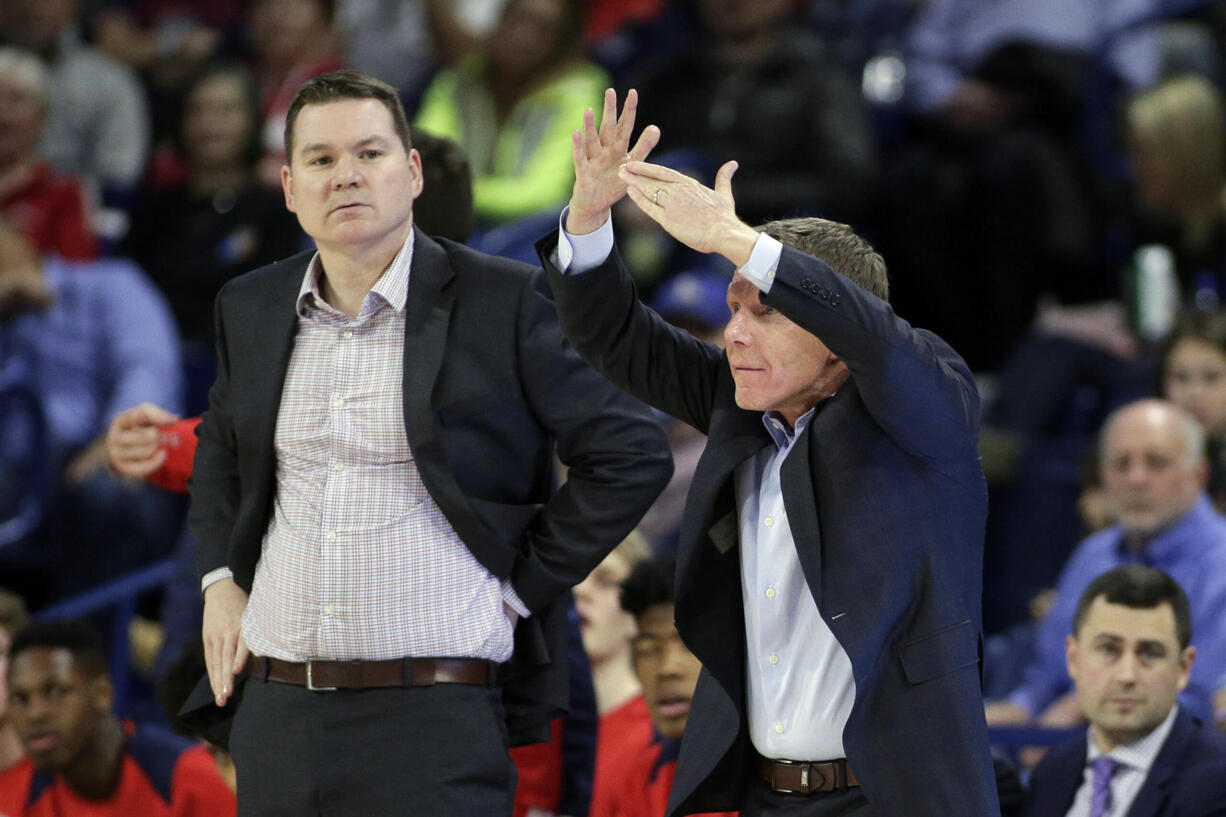 Gonzaga assistant coach Tommy Lloyd, left, alongside head coach Mark Few, has been hired as the new head coach at Arizona, Wednesday, April 14, 2021. The school says Lloyd, a graduate of Kelso High School, will receive a five-year contract, pending approval by the Arizona Board of Regents.