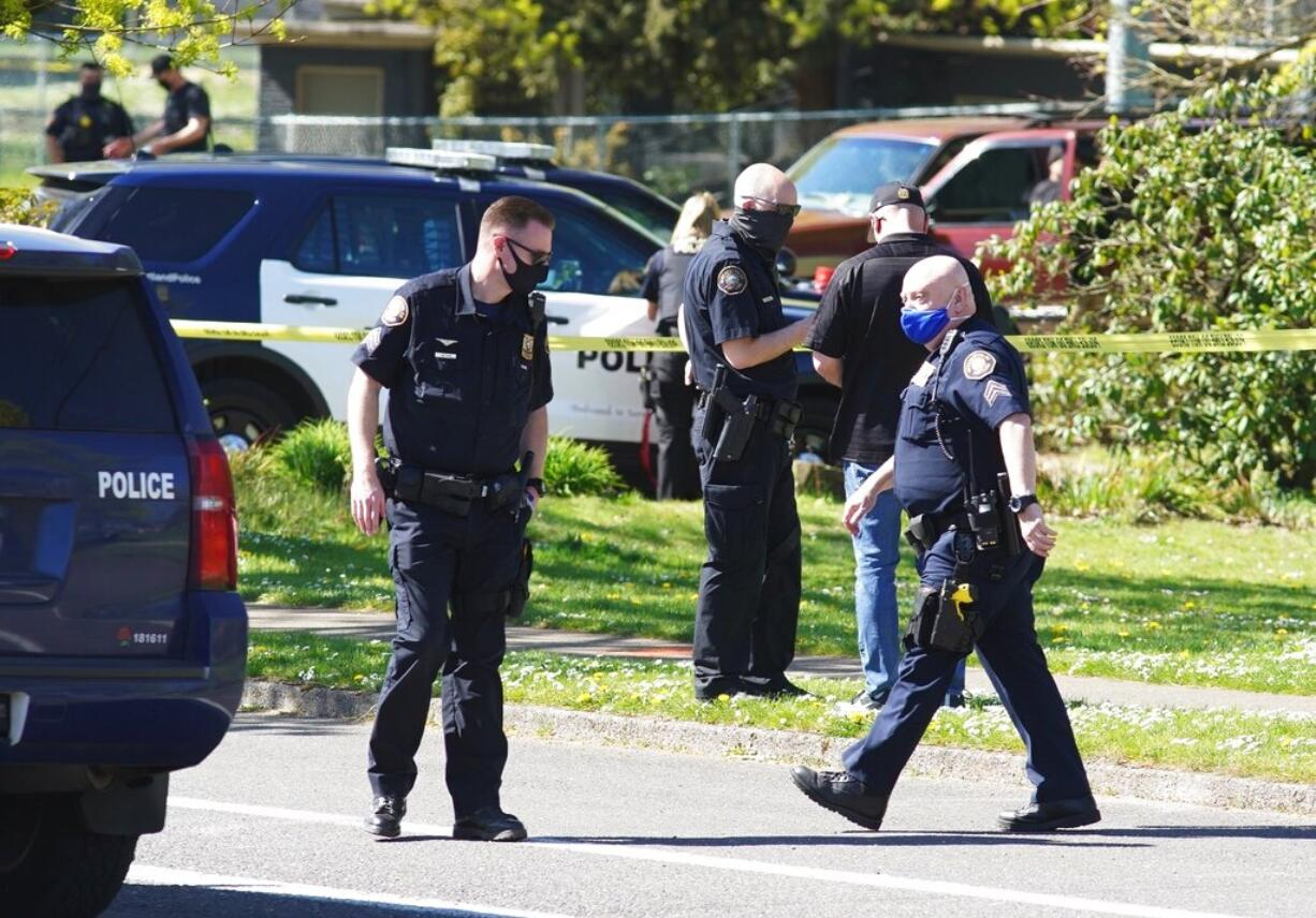 Law enforcement personnel work at the scene following a police involved shooting of a man at Lents Park, Friday, April 16, 2021, in Portland, Ore. Police fatally shot a man in the city park Friday morning after responding to reports of a person with a gun, authorities said.