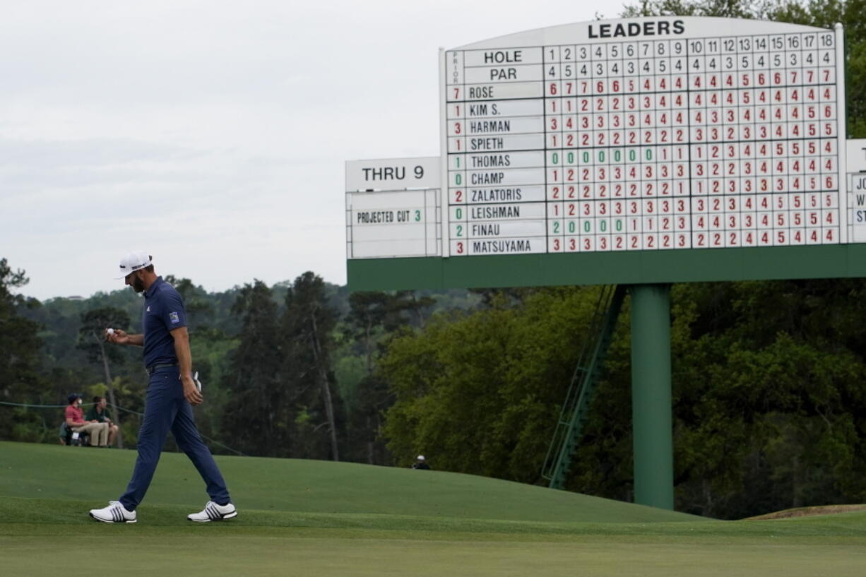 Dustin Johnson walks off the 18th green after his second round in the Masters golf tournament on Friday, April 9, 2021, in Augusta, Ga. (AP Photo/David J.