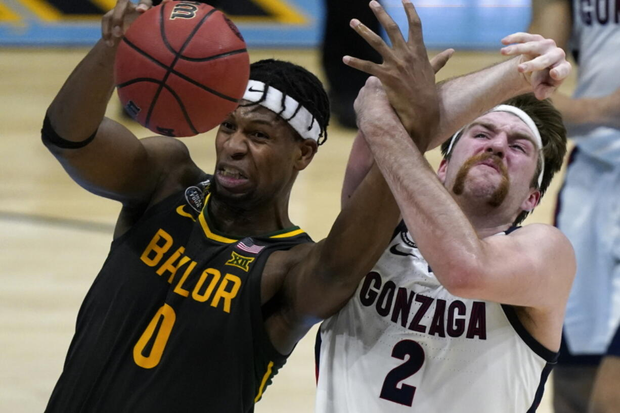 Baylor forward Flo Thamba (0) fights for a rebound with Gonzaga forward Drew Timme (2) during the first half of the championship game in the men's Final Four NCAA college basketball tournament, Monday, April 5, 2021, at Lucas Oil Stadium in Indianapolis.