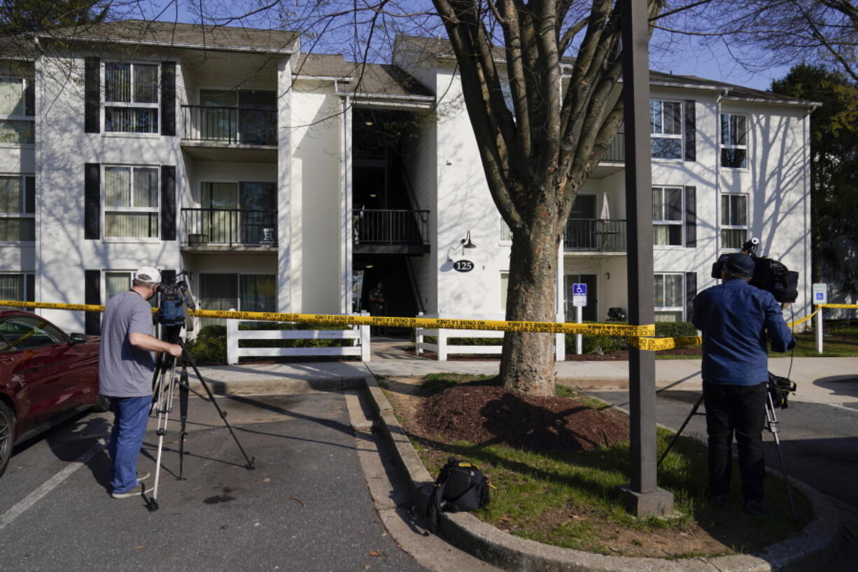 Television crew film outside the apartment of Navy Petty Ofc. 3rd Class Fantahun Girma Woldesenbet, assigned to Fort Detrick in Frederick, Md., Tuesday, April 6, 2021. Authorities say the Navy medic shot and wounded two U.S. sailors at a military facility before fleeing to a nearby Army base where security forces shot and killed him.