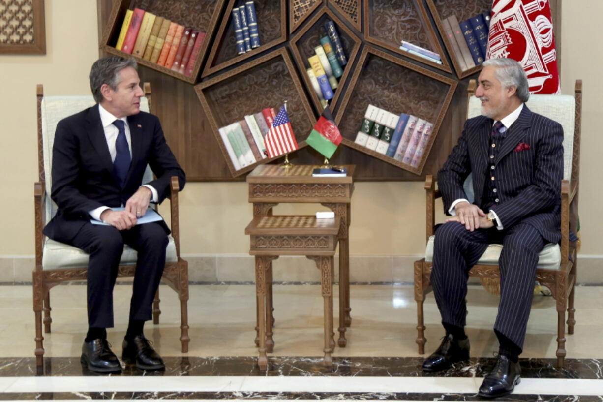 Abdullah Abdullah, Chairman of the High Council for National Reconciliation, right, meets with U.S. Secretary of State Antony Blinken, at the Sapidar Palace in Kabul, Afghanistan, Thursday, April 15, 2021. Blinken made an unannounced visit to Afghanistan on Thursday to sell Afghan leaders and a wary public on President Joe Biden's decision to withdraw all American troops from the country and end America's longest-running war.