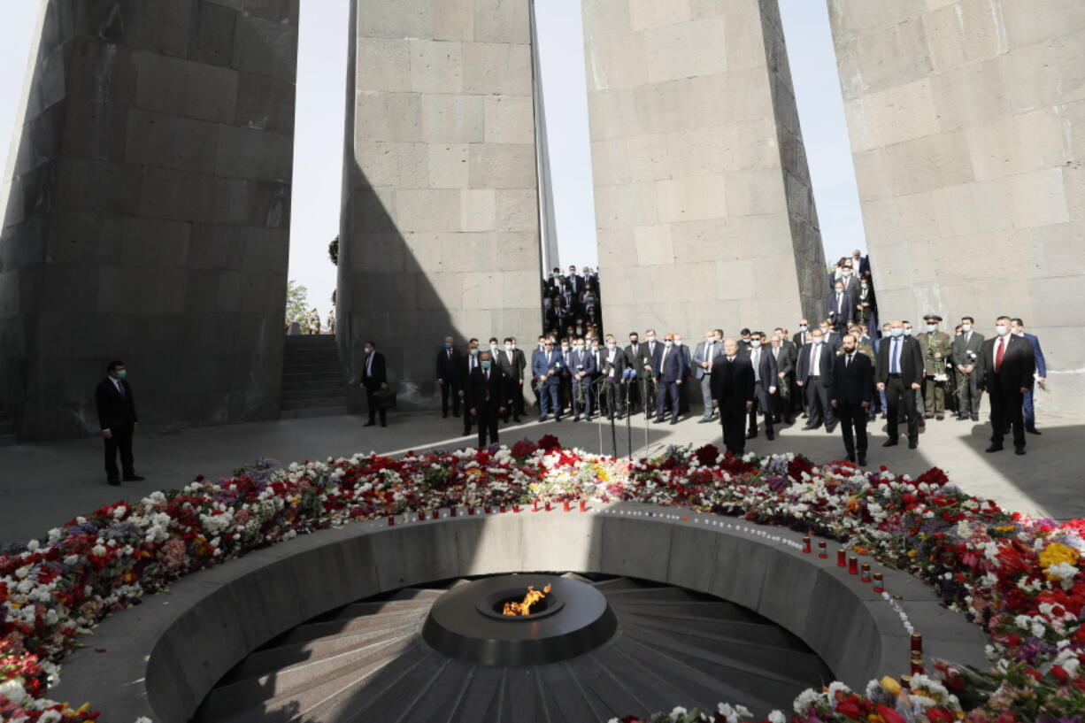 Armenian Prime Minister Nikol Pashinyan, center, attends a memorial service at the monument to the victims of mass killings by Ottoman Turks, to commemorate the 106th anniversary of the massacre, in Yerevan, Armenia, Saturday, April 24, 2021. Armenians marked the anniversary of the death of up to 1.5 million Armenians by Ottoman Turks, an event widely viewed by scholars as genocide, though Turkey refutes the claim.