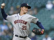 Houston Astros starting pitcher Zack Greinke throws to a Seattle Mariners batter during the first inning of a baseball game Saturday, April 17, 2021, in Seattle. (AP Photo/Ted S.