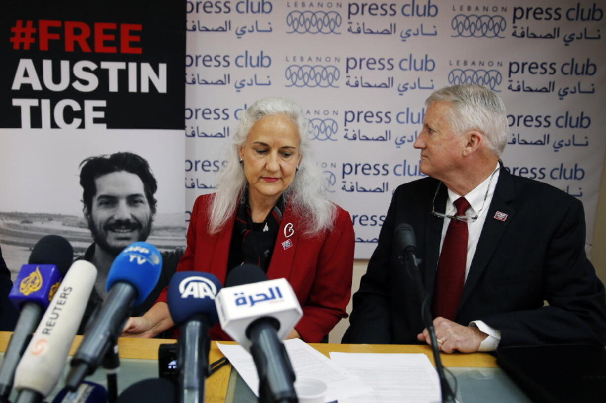 FILE - In this Dec. 4, 2018, file photo Marc and Debra Tice, the parents of Austin Tice, who is missing in Syria, speak during a press conference, at the Press Club, in Beirut, Lebanon. Talks between U.S. and Syrian officials last summer over the fate of Austin Tice and other American hostages foundered over conditions laid out by Damascus and because of a lack of meaningful information provided on the fate of Tice. That's according to people who spoke to The Associated Press in recent weeks about the secretive talks last August.
