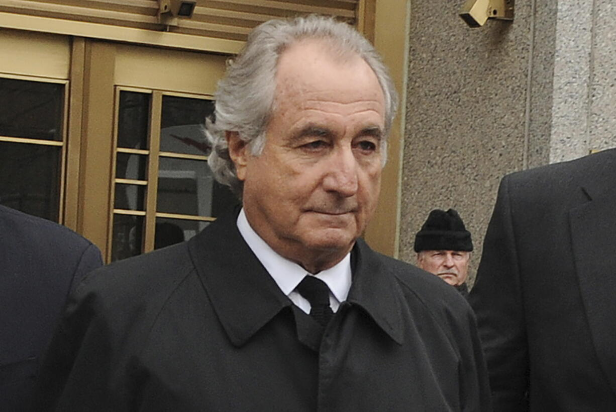 FILE - Bernard Madoff exits Manhattan federal court, Tuesday, March 10, 2009, in New York. Madoff, the financier who pleaded guilty to orchestrating the largest Ponzi scheme in history, died early Wednesday, April 14, 2021,  in a federal prison, a person familiar with the matter told The Associated Press.