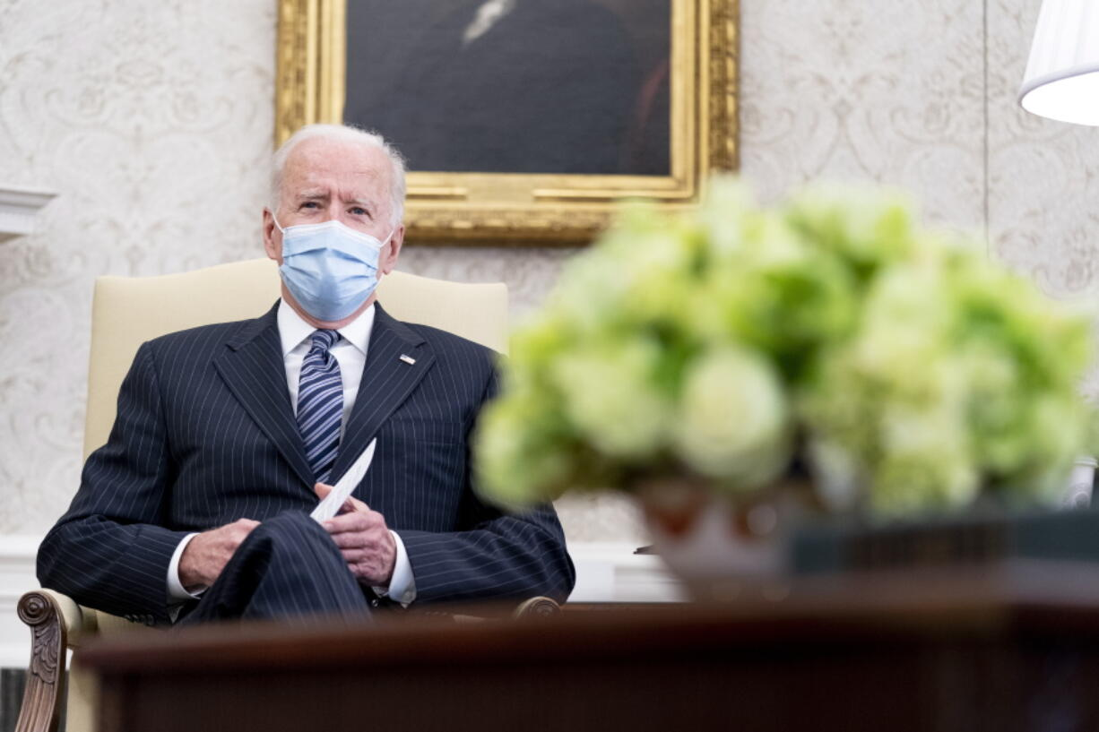 President Joe Biden meets with members of congress to discuss his jobs plan in the Oval Office of the White House in Washington, Monday, April 19, 2021.