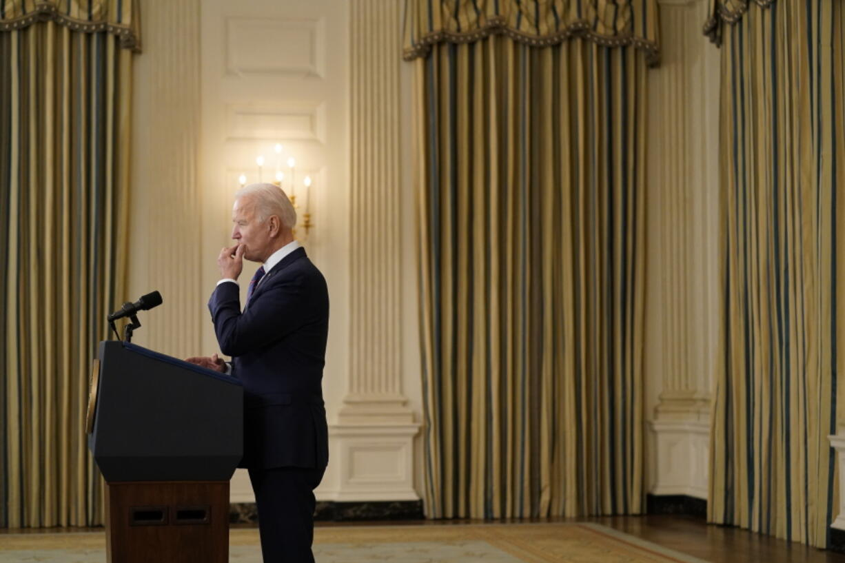 President Joe Biden pauses as he speaks about the March jobs report in the State Dining Room of the White House, Friday, April 2, 2021, in Washington.