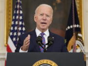 President Joe Biden speaks about the March jobs report in the State Dining Room of the White House, Friday, April 2, 2021, in Washington.